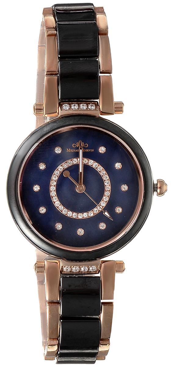 Часы наручные женские Mikhail Moskvin, цвет: золотой, черный. L5005S17B1BM8434-58AEСтильные женские наручные часы Mikhail Moskvin изготовлены из высокотехнологичной гипоаллергенной нержавеющей стали и дополнены изящным, высокопрочным керамическим браслетом. Для того чтобы защитить циферблат от повреждений в часах используется высокопрочное сапфировое стекло. Циферблат изделия оснащен часовой, минутной и секундной стрелками, оформлен символикой бренда. Большой, открытый циферблат часов, украшен циркониевыми вставками. Браслет комплектуется надежной и удобной в использовании застежкой-бабочкой, которая позволит с легкостью снимать и надевать часы. Часы упакованы в фирменную коробку. Часы Mikhail Moskvin подчеркнут характер и отменное чувство стиля их обладателя.