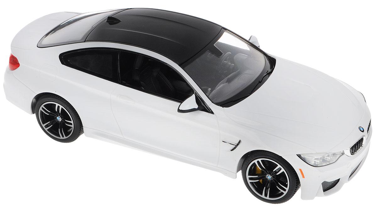 """Радиоуправляемая модель Rastar """"BMW M4 Coupe"""" обязательно привлечет внимание взрослого и ребенка и понравится любому, кто увлекается автомобилями. Маневренная и реалистичная модель выполнена в точной детализации с настоящим автомобилем в масштабе 1:14. Управление машинкой происходит с помощью пульта. Машина двигается вперед и назад, поворачивает направо, налево. Имеются световые эффекты. Колеса игрушки обеспечивают плавный ход, машина не портит напольное покрытие. Пульт управления работает на частоте 27 MHz. Радиоуправляемые игрушки способствуют развитию координации движений, моторики и ловкости. Ваш ребенок часами будет играть с моделью, придумывая различные истории и устраивая соревнования. Порадуйте его таким замечательным подарком! Модель автомобиля работает от 5 батареек напряжением 1,5V типа АА (не входят в комплект). Пульт управления работает от батарейки 9V типа """"Крона"""" (не входит в комплект)."""