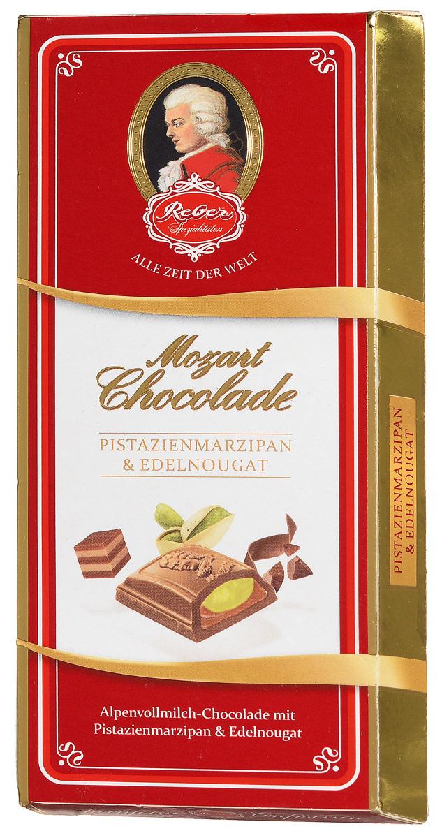 Reber AlpenVollmilch молочный шоколад с ореховым пралине и фисташковым марципаном, 100 г0120710Reber AlpenVollmilch - нежный молочный шоколад из альпийского молока с двуслойной начинкой из фисташкового марципанаи сладкой нуги из фундука.Марципан уравновешивает сладость нуги и молочного шоколада, поэтому вкус продукта получается сбалансированный, сдержанный и элегантный.Ракушка сделана из довольно толстого слоя шоколада, поэтому она очень приятно ломается, хрустит и сохраняет собственную форму и вкус.Шоколад из альпийского молока приготовлен по семейному рецепту Reber. Нугуделаютиз средиземноморского медленно обжаренного фундука, сахара, альпийского молока и меда.