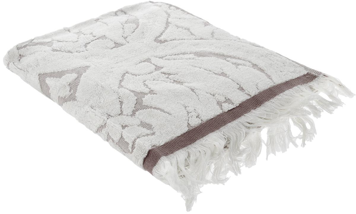 Полотенце Guten Morgen Лакшми, цвет: серый, 34 х 76 смCLP446При производстве полотенца Guten Morgen Лакшми используется сырье самого высокого качества: безопасные красители и 100% хлопок. Полотенца - это просто необходимый атрибут каждой ванной комнаты в любом доме. Полотенца Guten Morgen отлично впитывают влагу, комфортны для кожи, не содержат аллергенных красителей, имеют стойкий к стирке цвет.Состав: 100% хлопок; Размер: 34 х 76 см.