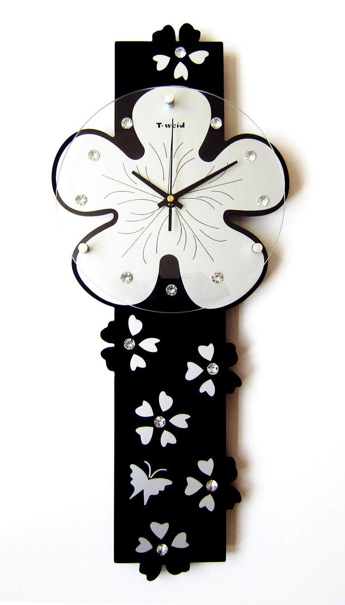 Часы настенные T-Weid, цвет: черный, 25 х 59 х 5 см94672Настенные кварцевые часы - это прекрасный предмет декора, а также универсальный подарок практически по любому поводу. Корпус часов, выполнен из дерева с черным матовым покрытием.Циферблат часов оснащен тремя фигурными стрелками: часовой, минутной и секундной. Часы украшены стразами. Циферблат и стрелки защищены прочным стеклом, который крепится четырьмя металлическими крепежами к корпусу. На задней стенке часов расположена металлическая петелька для подвешивания и блок с часовым механизмом. Часы прекрасно впишутся в любой интерьер. Тип механизма: плавающий, бесшумный. Рекомендуется докупить батарейку типа АА (не входит в комплект).