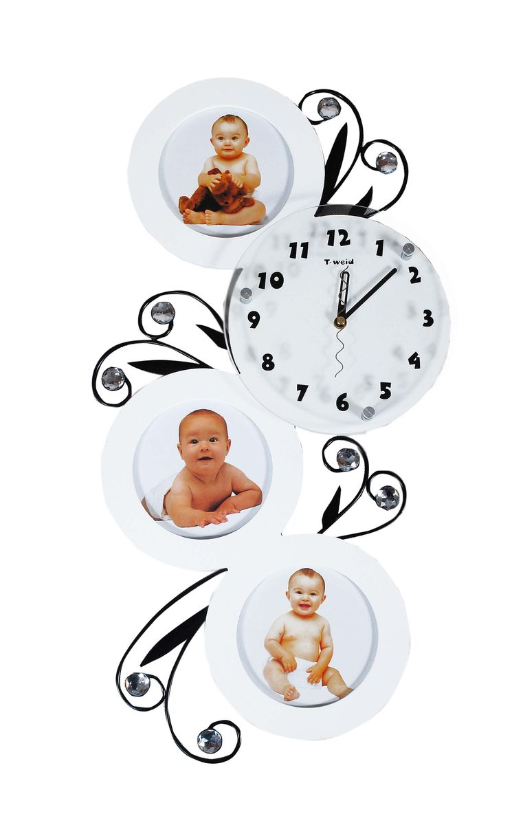 Часы настенные T-Weid, с фоторамками, цвет: белый, 32 х 59 х 5 см97495Настенные кварцевые часы с фоторамками - это прекрасный предмет декора, а также универсальный подарок практически по любому поводу. Корпус часов, выполнен из дерева с белым матовым покрытием, декорирован изображениями металлических веток с листьями и украшен стразами, так же оформлен тремя круглыми фоторамками. Циферблат часов оснащен тремя фигурными стрелками: часовой, минутной и секундной. Циферблат и стрелки защищены прочным стеклом, который крепится четырьмя металлическими крепежами к корпусу. На задней стенке часов расположена металлическая петелька для подвешивания и блок с часовым механизмом. Часы с фоторамками прекрасно впишутся в любой интерьер. В зависимости оттого, что вы поместите в рамки, будет меняться и стиль часов. Тип механизма: плавающий, бесшумный. Рекомендуется докупить батарейку типа АА (не входит в комплект). Для 3 фото 13 х 13 см.