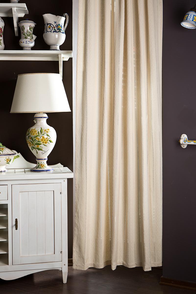 Штора Arloni Лэйс, на ленте, цвет: слоновая кость, высота 260 смSVC-300Штора Arloni - прекрасное решение для интерьера спальни или гостиной. Штора выполнена из натурального хлопка и оформлена изысканными мережками. Тонкое плетение, стиль и оригинальный дизайн сделают штору Лэйс настоящим украшением окна. Изделие выполнено из экологически чистого материала, отличается качеством пошива, легко стирается и сохраняет замечательный внешний вид долгое время. При стирке специально обработанная ткань не красится, а максимальная усадка не превышает 1%.Штора крепится к карнизу при помощи ленты с петлями. Шторы - это важный предмет интерьера, они создают уютную атмосферу и добавляют в интерьер изысканности и стиля!