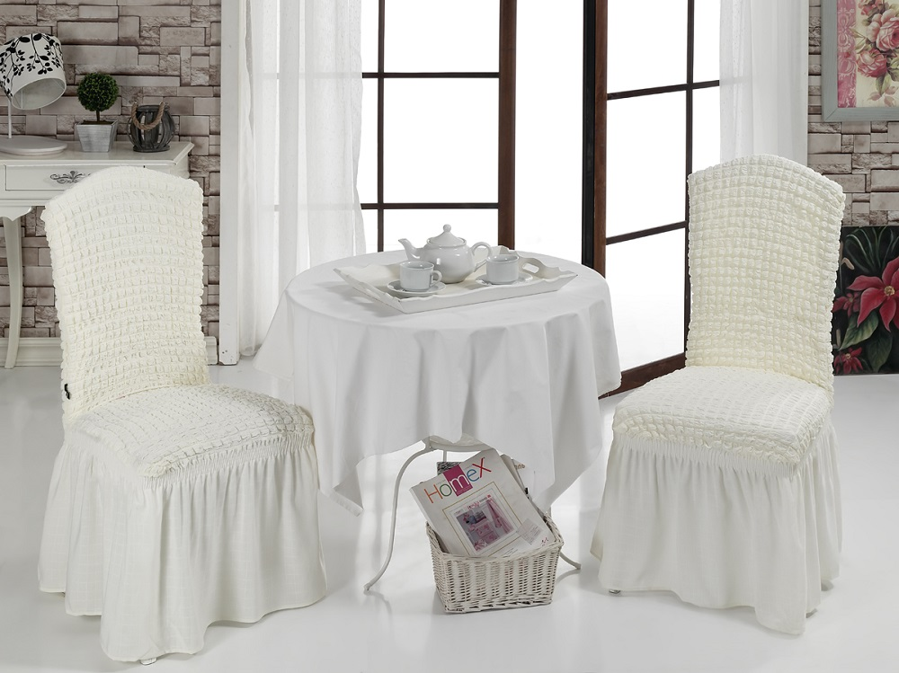 Набор чехлов для стульев Karna Bulsan, 2 шт, цвет: кремовый1906/CHAR010Набор Karna Bulsan состоит из двух универсальных чехлов для стульев, изготовленных из высококачественного материала на основе полиэстера и хлопка и дополненных широкой юбкой, скрывающей низ мебели. Изделия оснащены фиксаторами, которые позволяют надежно закрепить чехол на мебели. Фиксаторы вставляются в расстояние между спинкой и сиденьем, фиксируя чехол в одном положении, и не позволяя ему съезжать и терять форму. Фиксаторы особенно необходимы в том случае, если у вас кожаная мебель или мебель нестандартных габаритов. Характеристики:Плотность: 360 гр/м2. Ширина и длина посадочного места: 35+30 см.Высота спинки от посадочного места: 50+30 см.Ширина спинки: 35+30 см.Высота юбки: 35 см.