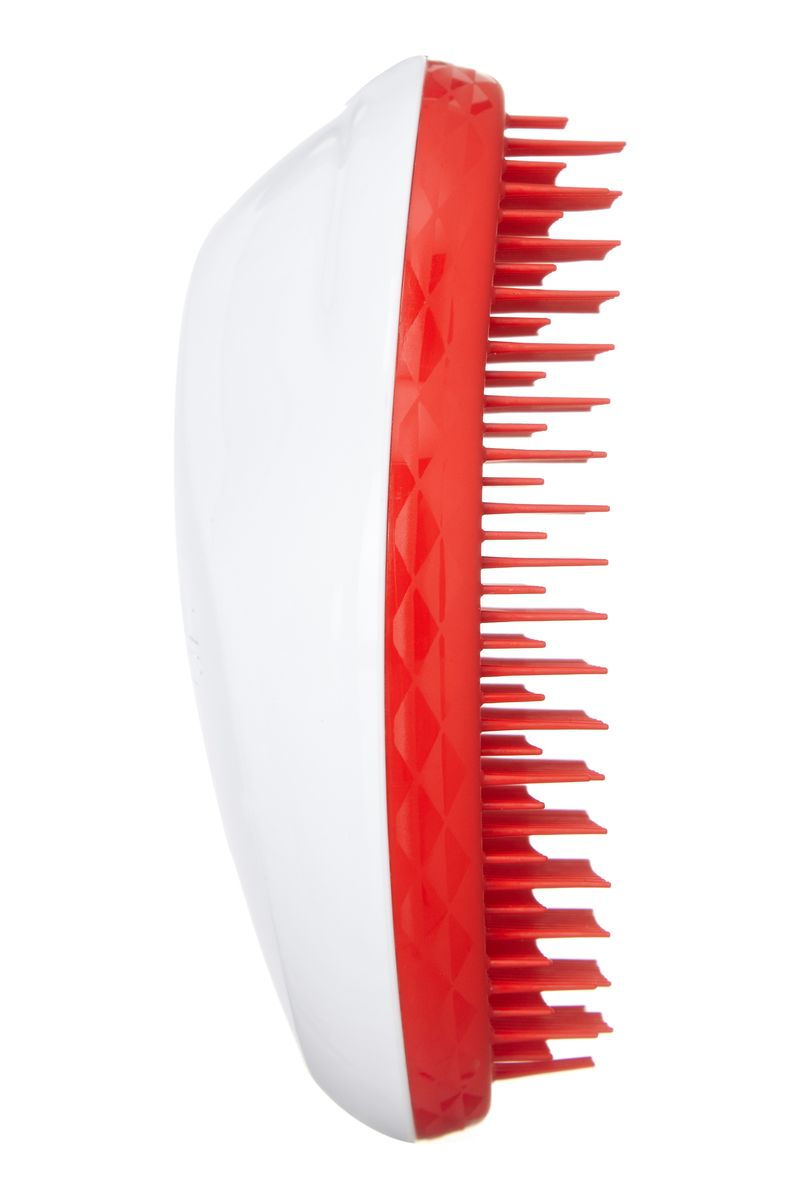 Tangle Teezer Расческа для волос The Original Christmas White/RedFS-00897Tangle Teezer – оригинальная профессиональная расческа для расчесывания волос, которая позволит вам с легкостью всего за одну минуту без рывков и напряжения расчесать мокрые, уязвимые или окрашенные волосы не нарушая структуру волос и не причиняя себе дискомфорта.