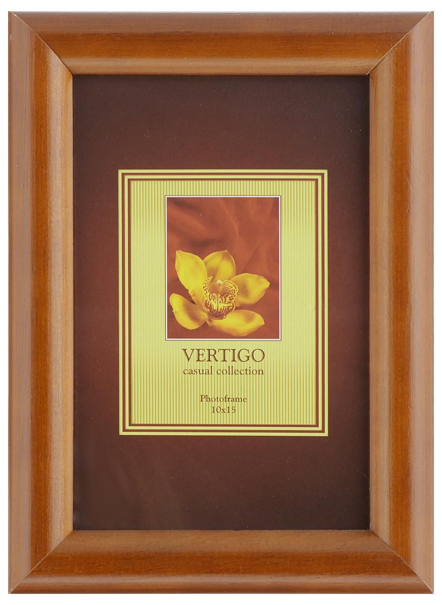 Фоторамка Vertigo Toscana, цвет: коричневый, 10 х 15 см12194 WF-022/194_коричневыйФоторамка Vertigo Toscana выполнена из дерева и стекла, защищающего фотографию. Обратная сторона рамки оснащена специальной ножкой, благодаря которой ее можно поставить на стол или любое другое место в доме или офисе. Также изделие оснащено специальными отверстиями для подвешивания на стену.Такая фоторамка поможет вам оригинально и стильно дополнить интерьер помещения, а также позволит сохранить память о дорогих вам людях и интересных событиях вашей жизни.