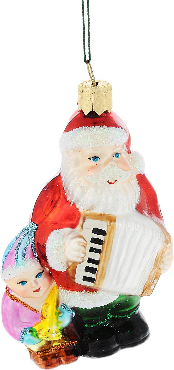 Украшение новогоднее подвесное Winter Wings Дед Мороз с гармошкой, высота 9 смDP-C40-13-15948Новогоднее украшение Winter Wings Дед Мороз с гармошкой отлично подойдет для декорации вашего дома и новогодней ели. Изделие, выполненное из стекла, декорировано блестками и оснащено специальной петелькой для подвешивания.Елочная игрушка - символ Нового года. Она несет в себе волшебство и красоту праздника. Создайте в своем доме атмосферу веселья и радости, украшая всей семьей новогоднюю елку нарядными игрушками, которые будут из года в год накапливать теплоту воспоминаний.