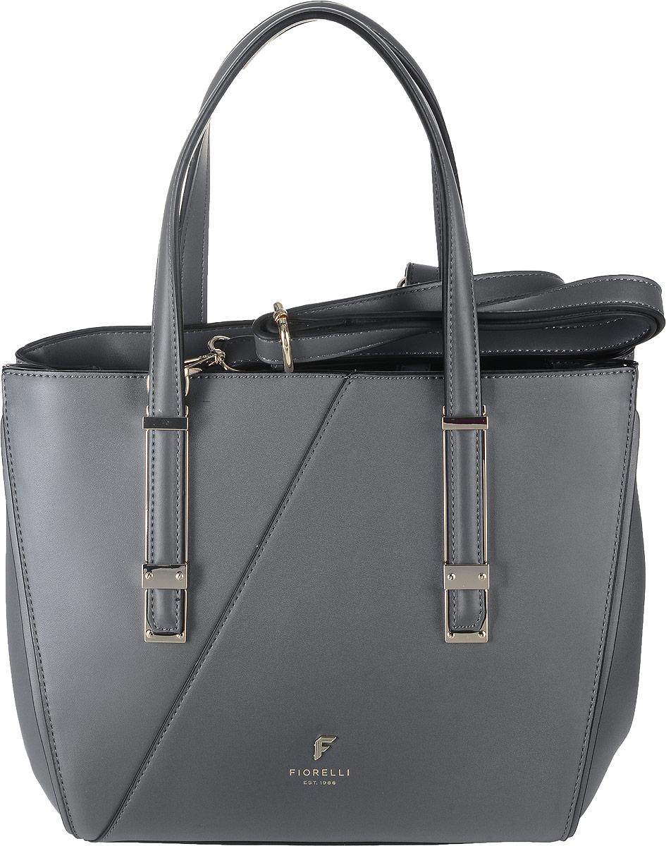 Сумка женская Fiorelli, цвет: серый. 8570 FH205065-001Стильная женская сумка Fiorelli изготовлена из эко-кожи. Изделие оформлено металлической пластинкой с логотипом бренда. Изделие оснащено удобными ручкамии металлическими ножками, которые предотвратят повреждение дна сумки. Также сумка оснащена съемным регулируемым плечевым ремнем, длина которого регулируется с помощью пряжки. Изделие закрывается хлястиками с магнитными кнопками. Внутри расположен карман-средник на молнии и вшитый карман на молнии. Также внутри находятся три открытых накладных кармана для телефона и мелочей.