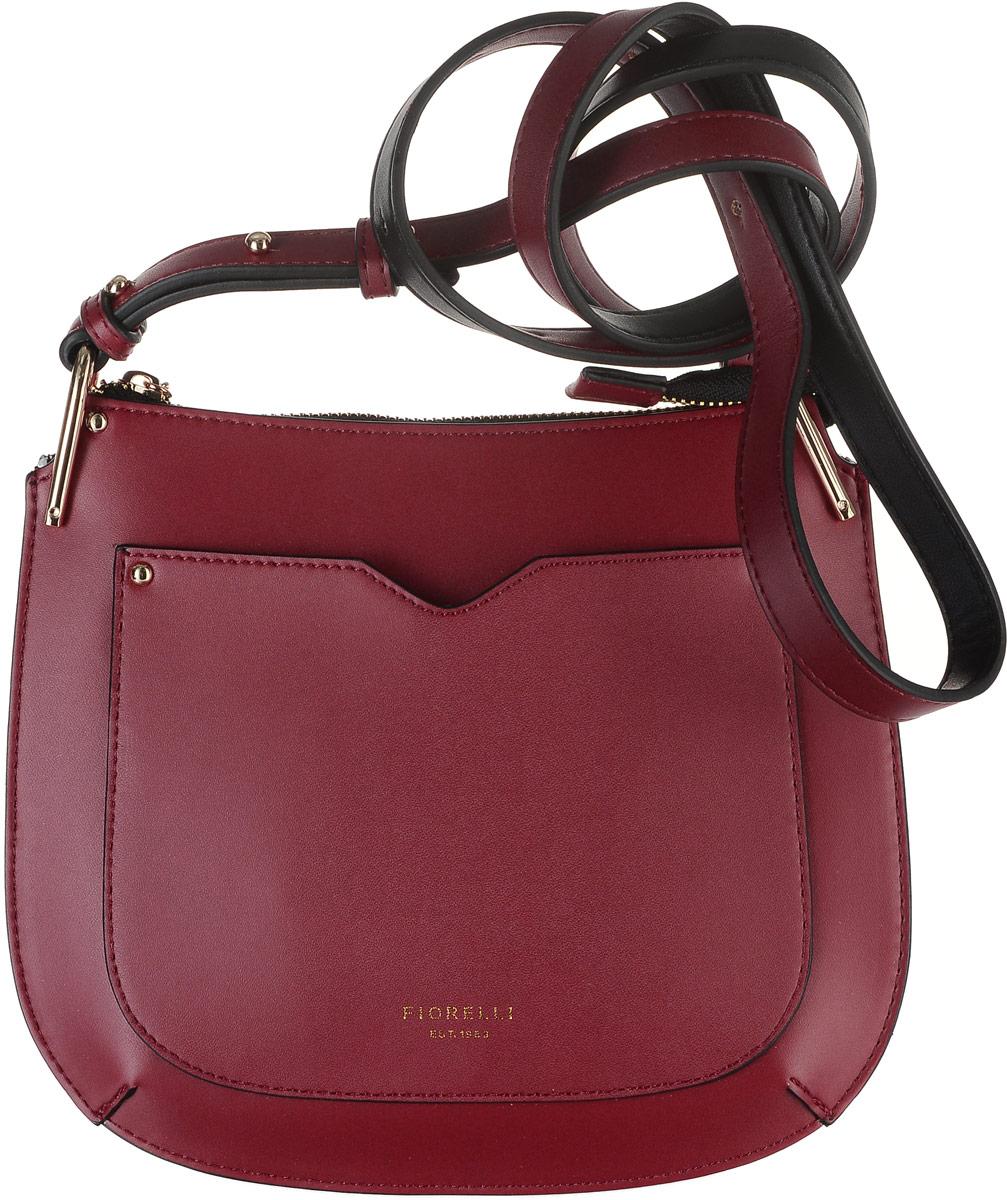 Сумка женская Fiorelli, цвет: красный. 8535 FHA-B86-05-CПрактичная маленькая сумка Fiorelli выполнена из приятной на ощупь искусственной кожи и закрывается на застежку-молнию, которая декорирована изящным пулером в виде золотистой цепочки с символикой бренда. Внутренний объем позволяет вместить в аксессуар все необходимое. Модель имеет одно основное отделение, внутри которого находится накладной кармашек для карточек и прочих мелочей. На тыльной стороне изделия имеется накладной карман. Сумка оснащена плечевым ремнем из искусственной кожи.Лаконичный цвет и оригинальная форма помогут этой сумочке вписаться даже в самый сложный и продуманный гардероб. Сумка Fiorelli - идеальный аксессуар вне моды и трендов.