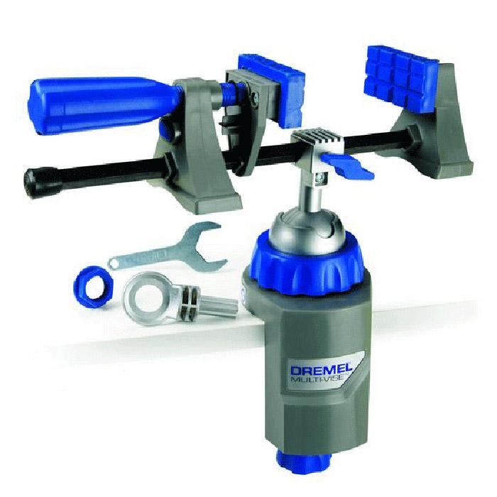 Тиски Dremel Multi-Vise 250080621Многофункциональные тиски Dremel Multi-Vise 2500 -это стационарные тиски, отдельный крепежный элемент и зажим для инструмента.Преимущества: - крепится на любой рабочий стол, платформу или облицовочный материал,- поворачивается на 360° и наклоняется на 50°. Позволяет работать с заготовкой под удобным углом,- губки можно использовать вместе с базовым блоком или отдельно как струбцину,- удобное расположение больших заготовок,- фиксирует большие предметы и защищает хрупкие детали от повреждения,- позволяет работать с круглыми деталями и заготовками неправильной формы,- позволяет быстро удалять предметы из зажима,- обеспечивает большую стабильность,- возможность присоединить фонарь DremeLite. Тиски Dremel Multi-Vise 2500 крепятся на любой верстак, рабочую платформу или поверхность толщиной до 6,3 мм. Материал рамы: пластик. Тип тисков: поворотные. Ширина: 190 мм.