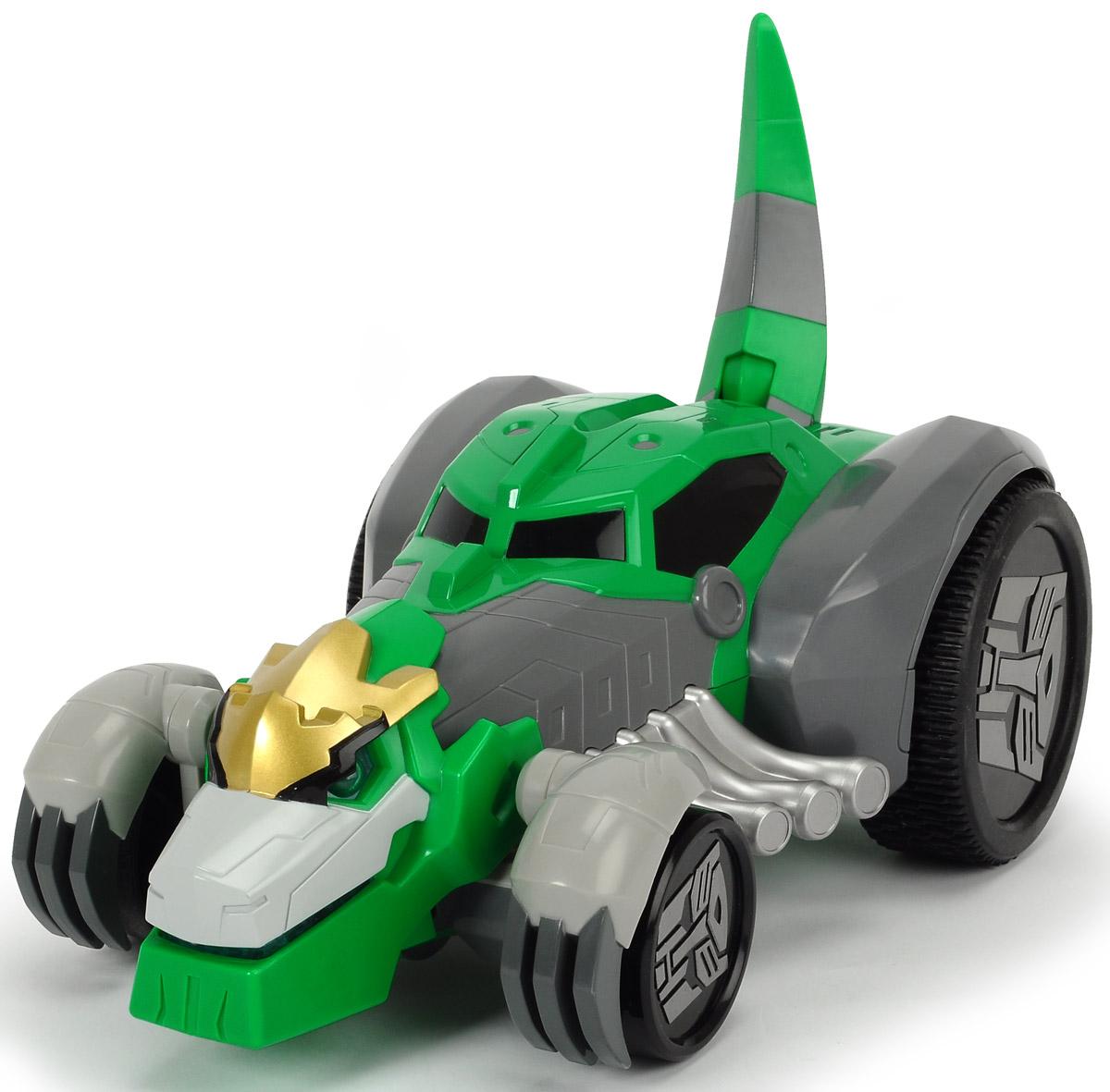 """Машинка-трансформер Dickie Toys """"Grimlock"""" - это необычная машинка, которая с помощью одной кнопки превращается в трансформера- динозавра Grimlock из мультфильма """"Трансформеры. Роботы под прикрытием"""". Главной особенностью персонажа этого популярного мультфильма по имени Гримлок была его трансформация из огромного динозавра в быстрый гоночный автомобиль, который не давал противнику шансов, уйти от погони. Теперь это настоящий боевой трансформер, который может ездить на задних колесах вперед и назад, налево и направо. Машинка имеет режим турбо, в котором достигает скорости до 8 км/ч. Пульт управления имеет световые и звуковые эффекты, а так же складывается и раскладывается. Время работы аккумулятора 30 минут, а время полной зарядки аккумулятора 120 минут. Машинка дополнена вращающимися колесами, диски которых украшены символикой трансформеров. Эта игрушка станет главным действующим лицом увлекательной игры, а ваш ребенок сможет придумать новую историю, проявив свою..."""