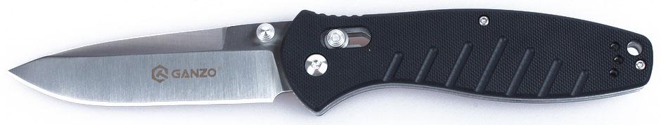 Нож туристический Ganzo, цвет: черный, стальной, длина лезвия 8,9 см. G738551701Аккуратный и качественный нож Ganzo необходим буквально каждому, кто предпочитает отдыхать активно. Ведь он понадобится и на рыбалке, и во время занятий экстремальными видами спорта, и просто на пикнике. Нож вполне подойдет для всех этих целей.Чтобы выдержать эксплуатацию в таких жестких условиях, какие предполагает отдых на природе, нож должен быть собран из самых качественных комплектующих. Так, клинок выполнен из нержавейки, которая нашла широкое применение в этой отрасли. Марка 440С содержит в составе целый ряд легирующих добавок, которые позволяют улучшить ее свойства, повысить стойкость к ржавлению и способность оставаться остро заточенной. Геометрия клинка грамотно продумана. Это drop point с пониженной линией обуха. Острие клинка немного приподнято, за счет чего режущая кромка фактически удлиняется. Заточка ножа ровная и ее легко подновить, используя самую обычную карманную точилку. Что касается габаритов клинка, то это длина 8,9 см, позволяющая легко использовать нож для чистки рыбы, приготовления бутербродов, и толщина 3,3 мм.В каждом из крайних положений (открытый и сложенный нож) лезвие хорошо фиксируется. Этому способствует использование замка Axis-Lock. В нем применяется небольшой металлический штифт, который и определяет положение клинка. Разблокировать такой замок можно даже одной рукой, что является несомненным преимуществом для туристов и охотников.Для рукоятки был выбран стеклопластик марки G10. Он заслужил доверие производителей и покупателей ножей благодаря невосприимчивости к коррозии и прочности. По этим признакам G10 существенно превосходит другие виды пластиков. Рукоятка ножа имеет удобные размеры и форму. Ее поверхность не гладкая, а текстурирована, к тому же, выскальзыванию рукоятки препятствуют длинные выемки в нижней части рукоятки. Они же служат декоративным элементом в общем дизайне. Длина лезвия: 8,9 см.Толщина обуха: 0,33 см.Общая длина ножа: 21 см.Вес но