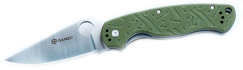 Нож туристический Ganzo, цвет: зеленый, стальной, длина лезвия 8,8 см. G7301G7301-GRОригинальный внешне и практичный по сути - таков нож Ganzo. Он ориентирован на максимально широкий круг покупателей и удовлетворит запросы рыбаков, охотников, туристов и любителей загородных прогулок, а также будет полезен в ежедневном использовании в городе. Клинок ножа гладко заточен и изготовлен из нержавеющей стали.Нож Ganzo привлекает внимание одновременно стильным внешним видом и практичными качествами. Этот нож напоминает легендарные Spyderco, поскольку на его клинке расположено сквозное круглое отверстие, заменяющее шпенек для открывания. Для клинка этого ножа производители выбрали нержавеющую сталь высокого качества, которая маркируется 440С. Твердость такой стали составляет около 58 единиц по шкале Роквелла, чего достаточно, чтобы нож длительное время оставался острым после каждой заточки.Возобновить его заточку можно при помощи домашней или даже карманной точилки. Тем более, что режущая кромка заточена по типу plain и подходит для работы с большинством различных материалов. При помощи этого ножа одинаково легко приготовить бутерброды для пикника или же отремонтировать рыболовные снасти, вскрыть упаковку посылки на почте и выполнить другие задачи. Длина клинка данной модели составляет 88 мм, а его толщина по обуху - 3,3 мм.Из общей длины ножа 122 мм приходится на рукоятку, которая изготовлена из стеклопластика G10. Это современный композитный материал, который наделен высокой прочностью и долговечностью, а также хорошо себя зарекомендовал при эксплуатации ножа в условиях жары или морозов. Стеклопластик не перегревается и не сильно охлаждается, а потому держать нож в руках будет комфортно в любое время года. Чтобы он не выскальзывал из мокрых ладоней, поверхность рукоятки фактурная. На рукоятке имеется клипса для фиксации ножа на поясном ремне или кармане.Важным фактором в пользу ножа Ganzo является и то, что в нем используется замок Liner-Lock. Это один из самых надежных и 