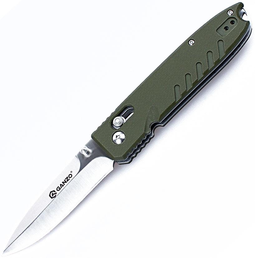 Нож туристический Ganzo, цвет: зеленый, стальной, длина лезвия 8,5 см. G746-1-GRG746-1-GRНож Ganzo привлекателен как с точки зрения функциональности, так и по его внешнему виду. Эта модель хорошо подойдет в качестве подарка, а также будет полезна для личного использования рыбакам, туристам, всем другим любителям загородного отдыха.Нож Ganzo - это практичный нож для поездок на природу. Он в состоянии справиться с приготовлением пищи, консервными банками, тонкими щепками для костра и другими туристическими задачами. Понадобится такой нож и охотникам, рыболовам. Его можно использовать не только на природе, но и в городе. Модель довольно компактна благодаря складной конструкции. Длина клинка равна 85 мм. Этого достаточно, чтобы работать с ножом было удобно. Полная же длина в открытом положении составляет 20 см.Для лезвия используется хорошая по качеству сталь 440С. Она относится к категории нержавеющих, но довольно твердая, чтобы сохранять острую заточку на протяжении длительного времени. Заточен нож полностью гладко, а форма клинка этой модели — drop-point, с острым кончиком. Поверхность клинка блестящая и обработана сатинированием. После этой обработки на металле видны небольшие штриховые полосы поперек клинка, указывающее направление обработки.Рукоятка ножа хорошо ложится в ладонь. Ее форма очень сдержанная и аккуратная. Снизу имеется несколько небольших волн, которые защищают пальцы пользователя от проскальзывания на лезвие. Накладки на стальную основу сделаны из композитного пластика G10. С одной стороны к ним прикреплена стальная клипса.Третья немаловажная деталь складного ножа Ganzo - это замок. Речь идет о механизме Axis Lock, основной деталью которого является подпружиненный штифт. Такой замок легко открыть при необходимости, но он ни в коем случае не даст ножу раскрыться самостоятельно. Поэтому носить нож в кармане совершенно безопасно. Единственное условие для его длительной службы — это поддержание механизма замка в чистоте.Длина лезвия: 8,5 см.Общая длина н