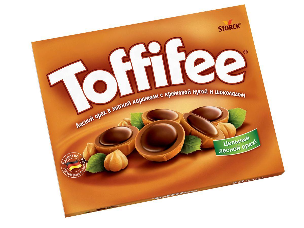 Toffifee Конфеты орешки в карамели, 200 г0120710Секрет конфет Toffifee в интересном сочетании вкуснейших ингредиентов: отборный цельный лесной орех в чашечке из мягкой карамели, наполненной нежной кремовой нугой и покрытой восхитительным шоколадом! Toffifee – это невероятно вкусные конфеты, которые понравятся и взрослым, и детям!