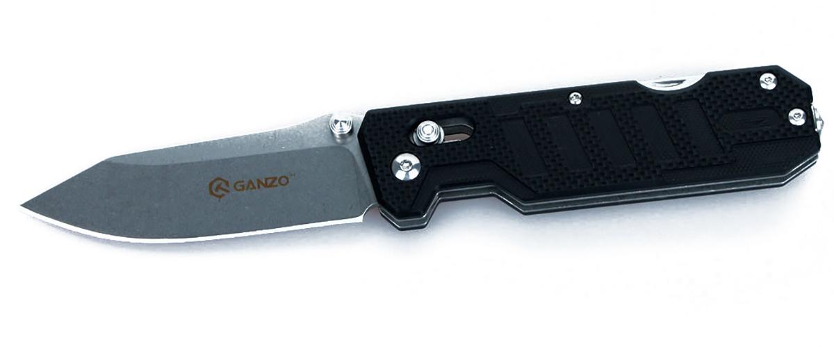 Нож туристический Ganzo, цвет: черный, стальной, длина лезвия 8,6 см. G735G735-BKСкладной нож Ganzo будет интересен одновременно и широкому кругу покупателей, и людям, увлекающимся экстремальными видами досуга на природе, а также профессиональным спасателям. Он располагает несколькими дополнительными инструментами, которые существенно расширяют базовую функциональность ножа.Клинок ножа, как и другие инструменты, изготовлен из качественной нержавеющей стали с маркировкой 440С. Это нержавеющая сталь с высоким уровнем антикоррозийных свойств. Твердость закалки сплава составляет +-58HRC. Таким образом, эта сталь долго держит острую заточку режущей кромки и может использоваться в условиях повышенной влажности.Лезвие ножа получило гладкую заточку Plain, которая считается универсальной и подходит практически для любых видов работ. Гладко заточенный нож делает ровные и максимально аккуратные разрезы. Клинок удерживается в выбранном положении за счет встроенного замка Axis-Lock. Это штифтовой механизм, который исключает вариант случайного срабатывания даже в том случае, если нож находится под нагрузкой. Важным моментом является то, что этот замок нужно периодически чистить и не допускать забивания внутрь грязи.Помимо клинка, нож располагает также дополнительными инструментами. В торцевой части рукоятки расположен стеклобой, а кроме того, в нее встроена открывалка для бутылок и консервных банок, с инструментом, который зачищает провода, и резак для веревок, ремней и строп. С их помощью вы легко справитесь с задачами, которые могут возникнуть в чрезвычайной ситуации, а также легче выполните некоторые стандартные виды работ во время пребывания за городом.Рукоятка данной модели ножа такая же практичная и долговечная, как и остальные его детали. Для нее используются накладки из композитного материала G10, который представляет собою соединение стекловолокна и эпоксидных смол. Это эргономичная и прочная ручка с фактурной не скользящей в руках поверхностью. Она не подвержена коррози