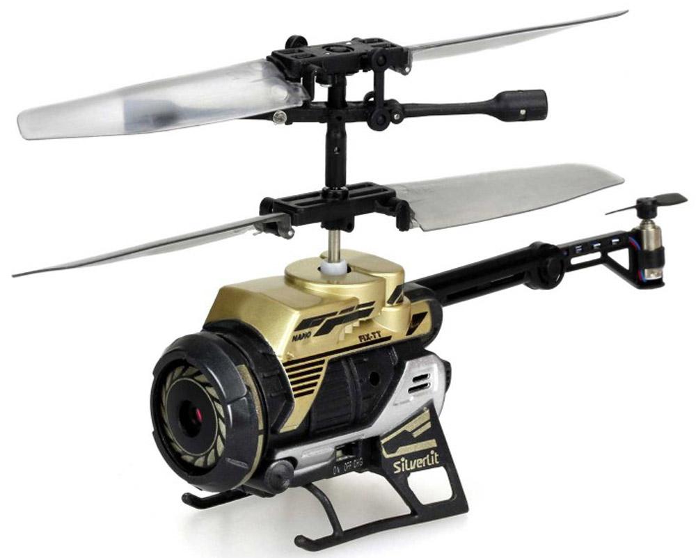 """Вертолет на радиоуправлении Silverlit """"Spy Cam Nano"""" привлечет внимание не только ребенка, но и взрослого, и станет отличным подарком любителю воздушной техники. Вертолет имеет инфракрасное дистанционное управление. Возможные движения: вверх, вниз, вправо, влево. Сверхточное цифровое управление позволяет совершать самые невероятные маневры. Встроенный гироскоп гарантирует стабилизацию полета в любых условиях. Пульт управления работает на частоте 2,4 ГГц, что позволяет управлять несколькими вертолетами без перебивания сигнала. Модель вертолета оснащена встроенной камерой с функцией фото и видеосъемки. Разрешение камеры составляет 640 х 480. Файлы записываются на карту памяти (приобретается отдельно). Все фотографии и видеозаписи можно перенести на компьютер с помощью кабеля USB. Вертолет также можно поместить внутрь пульта управления и использовать его, как фотоаппарат. Модель идеально подходит для игры внутри помещения. Каждый полет вертолета будет максимально..."""