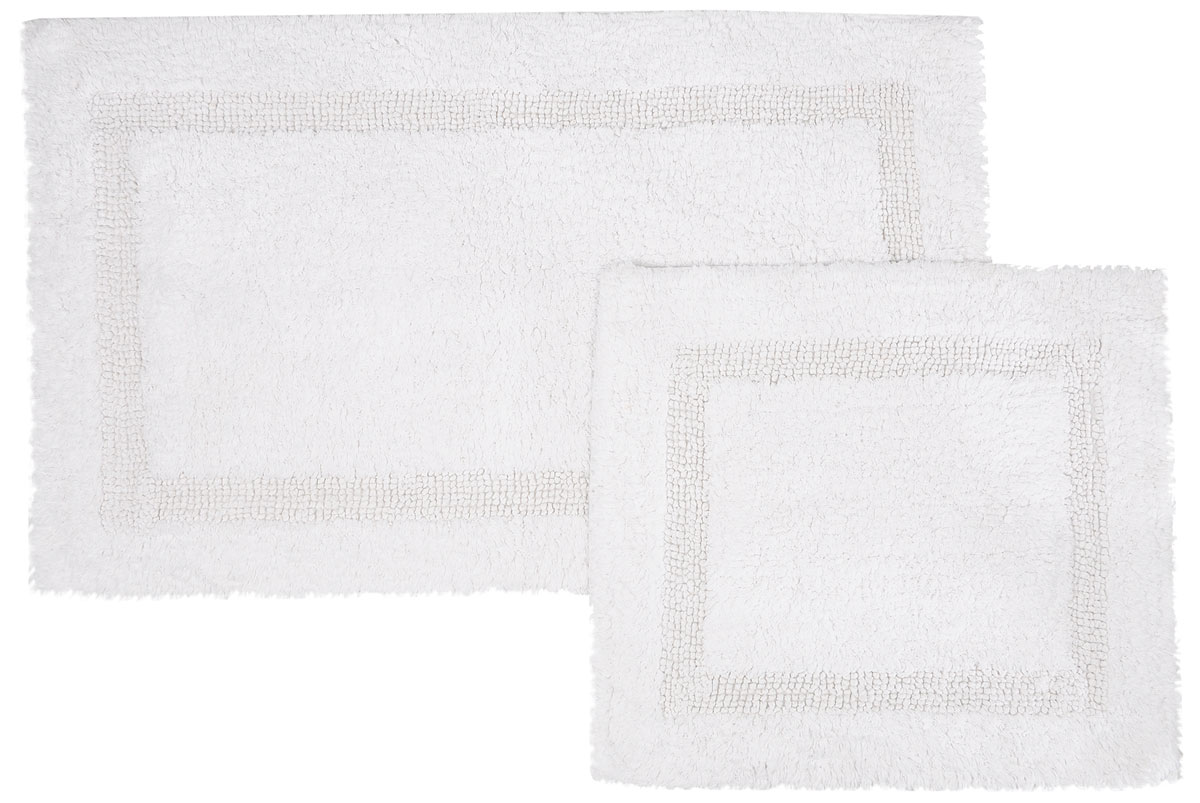 Набор ковриков для ванной Modalin Karla, цвет: белый, 2 шт8812Набор Modalin Karla, выполненный из высококачественного хлопка, состоит из двух ковриков для ванной комнаты. Изделия добавят тепло и уют, а также внесут неповторимый колорит в интерьер ванной комнаты. Высокая износостойкость ковриков и стойкость цвета позволит вам наслаждаться покупкой долгие годы.Размер большего коврика: 60 х 100 см.Размер малого коврика: 60 х 50 см.