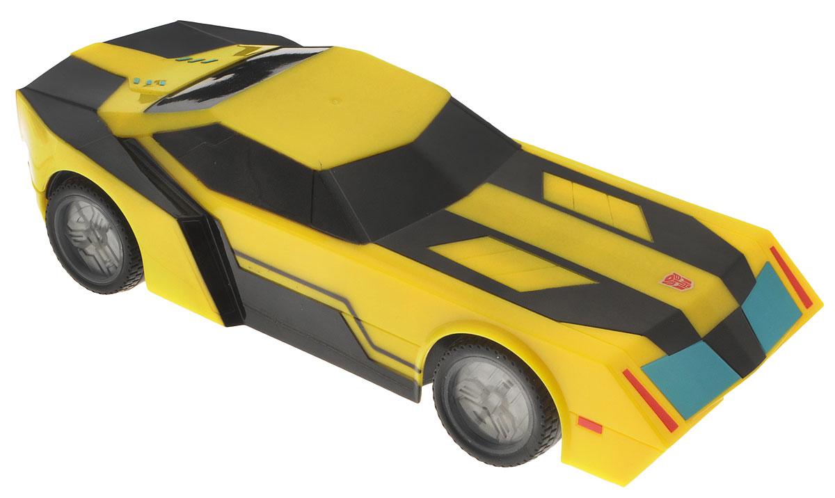 """Машина на радиоуправлении Dickie Toys """"Bumblebee"""" со световыми эффектами непременно понравится любому поклоннику трансформеров. Машина выполнена из безопасного и прочного материала. С помощью пульта управления машина может двигаться вперед-влево-вправо, назад-влево-вправо, останавливаться, а также имеется функция - турбо. Особую реалистичность игре с Бамблби придает неоновая подсветка дисков. Игрушка станет главным действующим лицом увлекательной игры по сюжету мультфильма или ребенок сможет придумать новую историю, проявив свою фантазию. Порадуйте своего ребенка таким замечательным подарком! Для работа машины необходимо купить 3 батарейки напряжением 1,5V типа АА (не входят в комплект). Для работы пульта управления необходимо купить 3 батарейки напряжением 1,5V типа AAA (не входят в комплект). Пульт управления работает на частоте 2,4 GHz."""