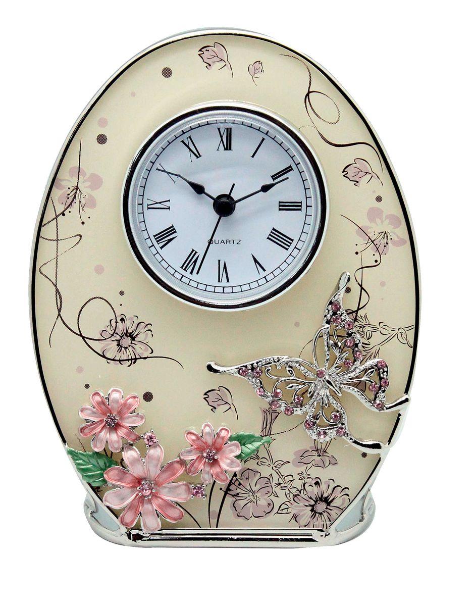 Часы настенные Jardin dEte Сиреневые сны, 16,2 х 12,5 смM 2051 BИнтерьерные часы Сиреневые сны от французского бренда Jardin DEte послужат прекрасным подарком для близкого человека и станут чудесным украшением интерьера любой комнаты. Этот элегантный аксессуар изготовлен из комбинированных материалов отличного качества и порадует своим роскошным оформлением.Овальный корпус изделия украшен объемными элементами в виде цветов и бабочки, усыпанными стразами, а циферблат выполнен в строгом, консервативном стиле. Такие замечательные настольные часы внесут неповторимую изюминку и значительно освежат атмосферу пространства.
