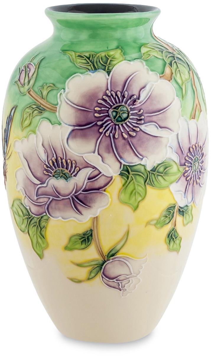 Ваза Pavone Камелия. JP-98/11JP-852/ 6Роскошная ваза Камелия напоминает древнюю амфору, её внешний вид имеет выпуклые формы, а дизайн содержит крупные сиреневые цветы. Каждый элемент правильно подобран, бутоны умело сочетаются с небольшими листьями, а общий вид рисунка вызывает восторг от ювелирной работы мастера.Фарфоровая ваза такой формы может стать украшением интерьера, либо применяться по своему назначению. Благодаря большому горлышку можно поставить большие букеты цветов, особенно с широкими листьями. Ваза создана дарить весеннее настроение и при дневном свете выглядит особенно красиво. Если вам трудно выбрать подарок к празднику для женщины, то такая ваза будет идеальным вариантом.
