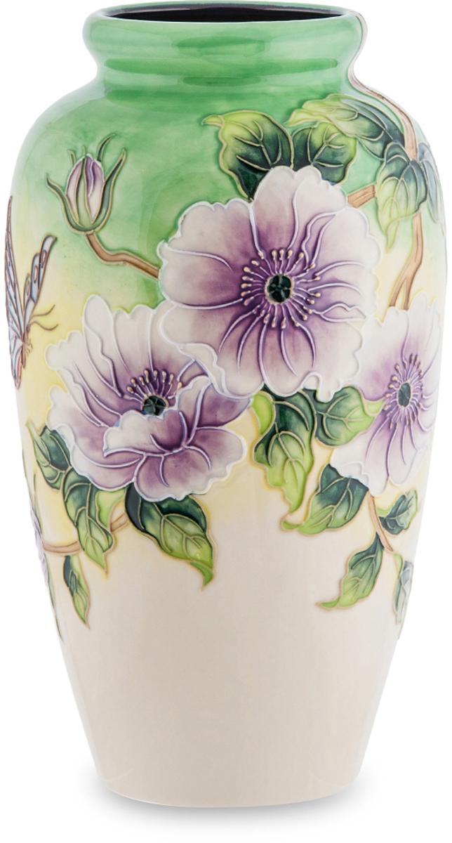 Ваза Pavone Камелия. JP-98/1254 009312Фарфоровая ваза Камелия ярко украшена цветочным орнаментом. Большие сиреневые цветы умело сочетаются со светло-зелёным основным фоном. Она может служить в качестве самостоятельного украшения, так как имеет большой размер и привлекательное цветочное оформление.Ваза подойдёт в качестве неповторимого подарка, подчеркнёт особенный имидж и статус человека. Практически все интерьеры с дорогим оформлением содержат фарфоровые вазы, поэтому она станет великолепным дополнением дизайна. Будет сочетать в себе изящество и красоту. Подарив такую вазу, вы принесёте в дом настоящее произведение искусства, воплощение красивой формы с гармоничным дизайном. Такой вазе не нужны цветы, она сама по себе красива.