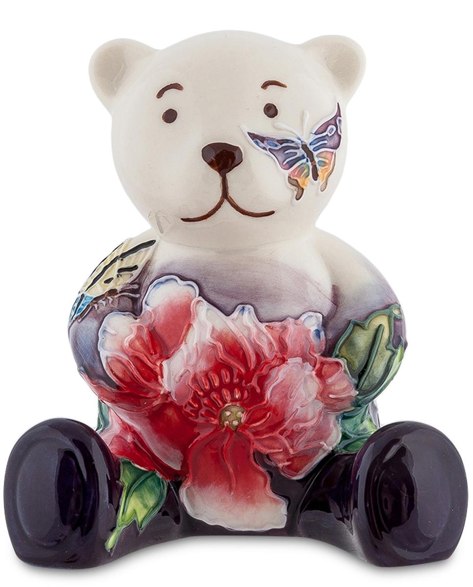 Фигурка декоративная Pavone МедвежонокTHN132NДекоративная фигурка Pavone Медвежонок станет оригинальным подарком для всех любителей стильных вещей. Сувенир выполнен из высококачественного фарфора в виде медвежонка, украшенного оригинальным узором. Изысканный сувенир станет прекрасным дополнением к интерьеру. Вы можете поставить фигурку в любом месте, где она будет удачно смотреться и радовать глаз.