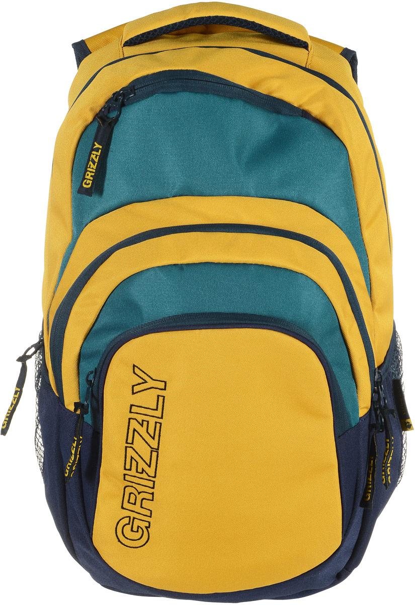 Grizzly Рюкзак цвет синий желтый RU-704-1/3730396Рюкзак Grizzly - это красивый и удобный рюкзак, который подойдет всем, кто хочет разнообразить свои будни. Рюкзак выполнен из плотного яркого материала. Рюкзак имеет два основных отделения, которые закрываются на застежки-молнии. Первое отделение содержит внутри открытый мягкий карман на хлястике с липучкой. Второе отделение содержит карман-сетку на молнии и три маленьких открытых кармашка. На лицевой стороне рюкзака вверху и внизу расположены дополнительные карманы на молниях. По бокам рюкзак дополнен открытыми кармашками на резинках.Рюкзак оснащен широкой ручкой для переноски и грудной стяжкой ремней. Широкие лямки можно регулировать по длине. Многофункциональный рюкзак станет незаменимым спутником вашего ребенка.