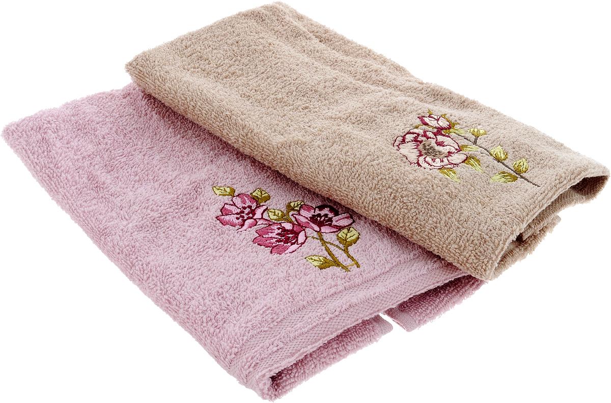 Набор кухонных полотенец Karna Santa, цвет: бежевый, светло-розовый, 30 х 50 см, 2 штVT-1520(SR)Набор Karna Santa состоит из 2 прямоугольных полотенец, которые выполнены из высококачественного хлопка и украшены вышивкой. Изделия гипоаллергенны, отлично впитывают влагу, быстро сохнут, сохраняют цвет и не теряют форму даже после многократных стирок. Такие полотенца очень практичны и неприхотливы в уходе. Набор Karna станет отличным помощником и украсит интерьер вашей кухни.