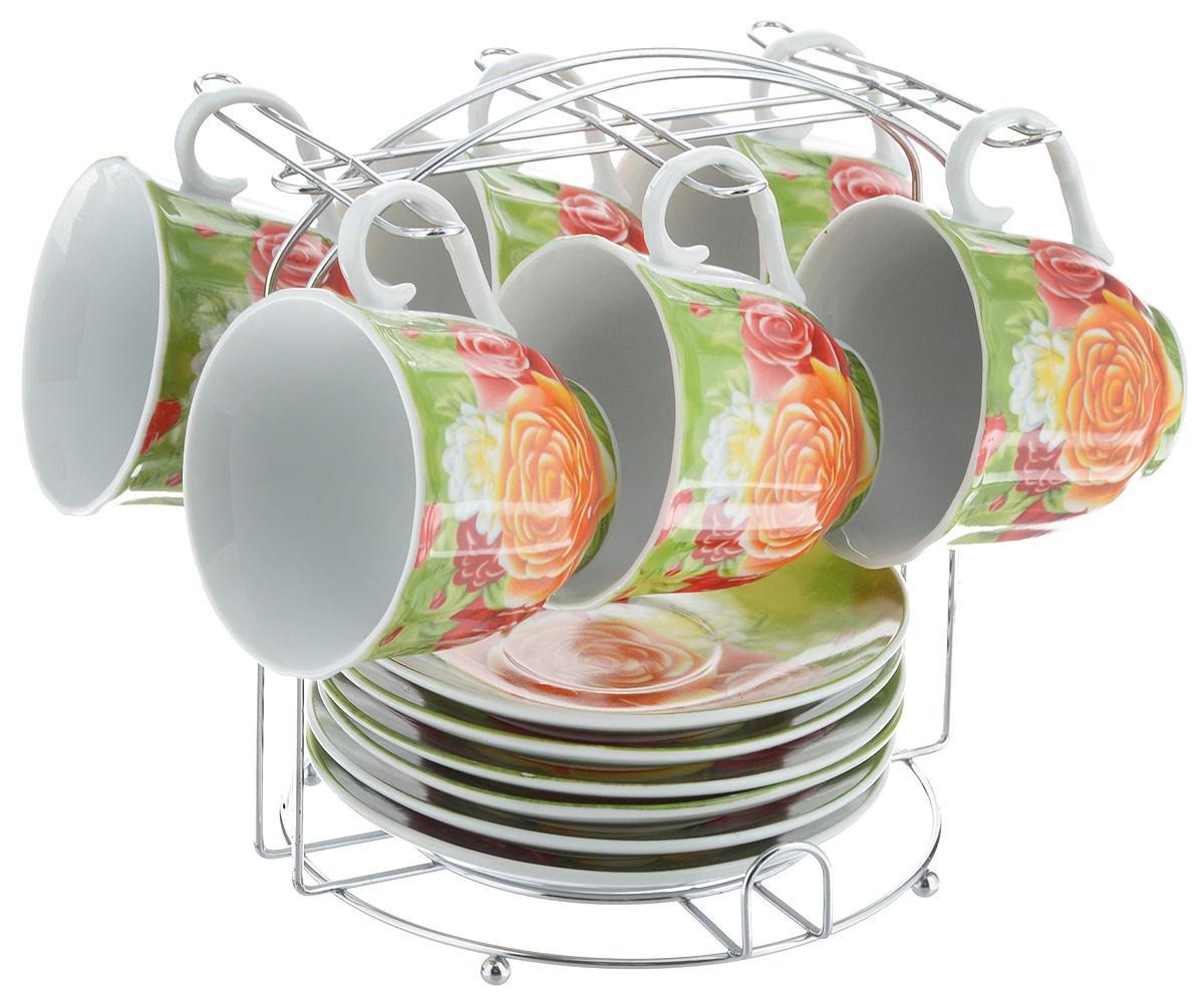 Набор чайный Bella, 13 предметов. DL-F6MS-024115510Набор Bella состоит из 6 чашек и 6 блюдец, изготовленных из высококачественного фарфора. Чашки оформлены красочным рисунком. Изделия расположены на металлической подставке. Такой набор подходит для подачи чая или кофе.Изящный дизайн придется по вкусу и ценителям классики, и тем, кто предпочитает современный стиль. Он настроит на позитивный лад и подарит хорошее настроение с самого утра. Чайный набор Bella - идеальный и необходимый подарок для вашего дома и для ваших друзей в праздники.Объем чашки: 220 мл. Диаметр чашки (по верхнему краю): 8 см. Высота чашки: 7 см. Диаметр блюдца: 14 см. Высота блюдца: 2,3 см.Размер подставки: 17 х 16,5 х 19 см.