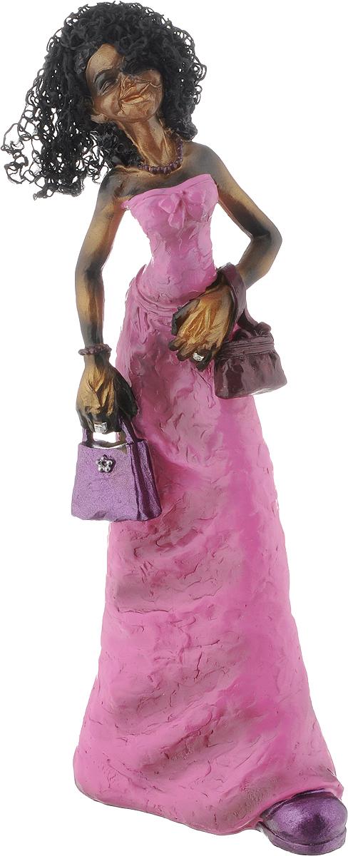 Фигурка декоративная House & Holder Дама с сумочкой, высота 29,5 смNLED-420-1.5W-RДекоративная фигурка House & Holder С сумочкой выполнена из пластика в виде африканки в ярко-розовом платье. Волосы девушки выполнены из текстиля. Вы можете поставить фигурку в любом месте, где она будет удачно смотреться, и радовать глаз. Сувенир отлично подойдет в качестве подарка близким или друзьям.Размер фигурки: 11,5 х 6,5 х 29,5 см.