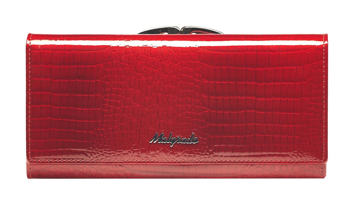 Кошелек женский Malgrado, цвет: красный. 72031-3-44BM8434-58AEСтильный кошелек Malgrado изготовлен из натуральной кожи красного цвета с декоративным тиснением под рептилию и вмещает в себя купюры в развернутом виде в полную длину. Внутри содержит четыре отделения для купюр, одно из которых на молнии, четыре кармана для дисконтных карт, визиток, кредиток, один прозрачный кармашек, в который можно положить пропуск, проездной документ или фотографию и дополнительный потайной карман. Снаружи расположен один отдел для мелочи, который закрывается на рамочный замок. Закрывается кошелек клапаном на кнопку.Кошелек упакован в подарочную металлическую коробку с логотипом фирмы. Такой кошелек станет замечательным подарком человеку, ценящему качественные и практичные вещи. Характеристики:Материал: натуральная кожа, текстиль, металл. Размер кошелька: 18,5 см х 9 см х 3 см. Цвет: красный. Размер упаковки:23 см х 13 см х 4,5 см. Артикул: 72031-3-44.