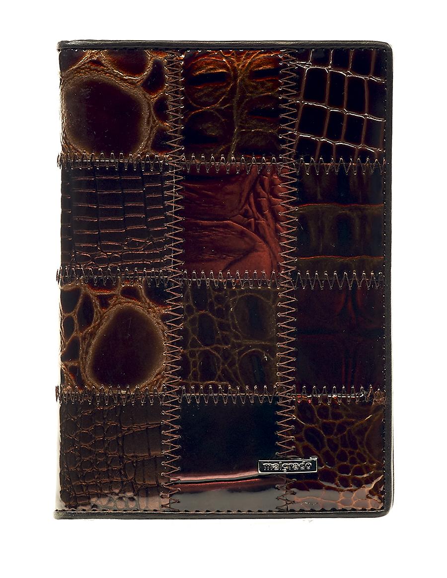 Обложка для паспорта женская Malgrado, цвет: коричневый. 54019-1A-49054019-1A-490A CoffeeСтильная обложка для паспорта Malgrado выполнена из натуральной лакированной кожи с тиснением под рептилию и оформлена металлической фурнитурой с символикой бренда.Изделие раскладывается пополам. Внутри расположены два накладных кармана, один из которых дополнен прозрачной вставкой из пластика, и пять накладных кармашков для пластиковых карт или визиток. Изделие дополнено съемным блоком для хранения автодокументов. Блок включает в себя четыре стандартных файла, один файл для хранения водительского удостоверения и один файл формата А3. Обложка для паспорта поставляется в фирменной упаковке.Обложка для паспорта поможет сохранить внешний вид ваших документов и защитит их от повреждений, а также станет стильным аксессуаром, который подчеркнет ваш образ.
