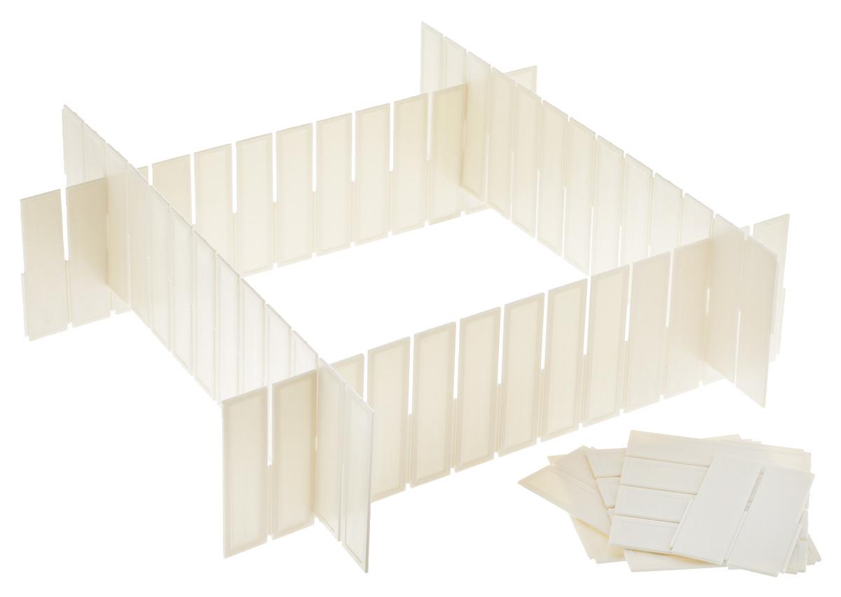 Разделитель для ящиков LOKS, цвет: светло-серый, 43 х 9 см, 4 шт1092019Разделитель для ящиков LOKS выполнен из пластика светло-серого цвета и предназначен для организации пространства в ящиках столов и шкафов. Особая конструкция изделия позволяет оптимально подобрать размер секций под разные типы ящиков. Разделители легко устанавливаются и регулируются по длине. В комплекте - 4 штуки.Размер разделителя: 43 см х 9 см.