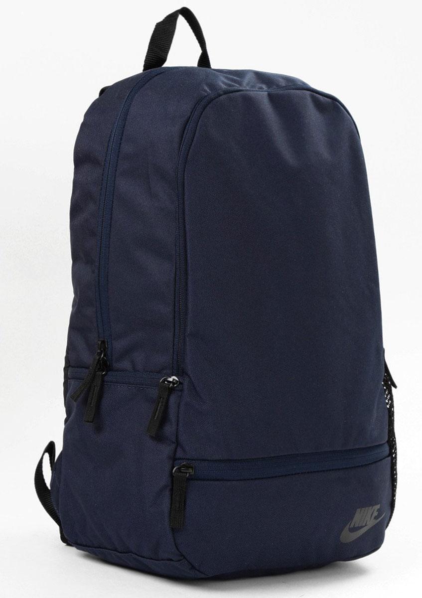 Рюкзак городской Nike Classic North - Solid, цвет: темно-синий, 20 лBP-001 BKРюкзак Nike Classic North Solid из плотного износостойкого полиэстера. Вместительное основное отделение и многочисленные карманы. Мягкие регулируемые лямки и спинка, боковой карман на молнии.