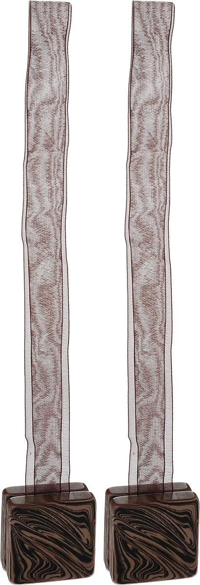 Подхват для штор TexRepublic Ajur. Lenta, на магнитах, цвет: коричневый, 2 шт. 79029S03301004Изящный подхват для штор TexRepublic Ajur. Lenta, выполненный из пластика и текстиля, можно использовать как держатель для штор или для формирования декоративных складок на ткани. С его помощью можно зафиксировать шторы или скрепить их, придать им требуемое положение, сделать симметричные складки. Благодаря магнитам подхват легко надевается и снимается.Подхват для штор является универсальным изделием, которое превосходно подойдет для любых видов штор. Подхваты придадут шторам восхитительный, стильный внешний вид и добавят уют в интерьер помещения.Длина подхвата: 37 см.Количество: 2 шт.