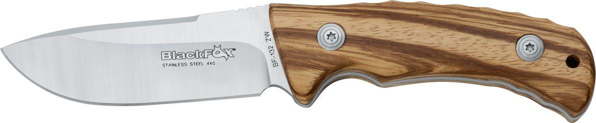 Нож Fox Black Fox, цвет: коричневый, длина клинка 9 см. OF/BF-132OF/BF-132Итальянская компания Фокс выпускает очень удачные туристические ножи, и одним из отличнейших вариантов этого направления является Black Fox. Несмотря на свой относительно небольшой размер (общая длина 200 мм при длине лезвия 90 мм) и вес - 155 г, он весьма функционален и выполнит множество поставленных перед ним задач. С Black Fox у вас не возникнет проблем с разведением костра, нарезанием ветвей, разрезанием любых веревок и сетей, изготовлением ловушек и прочими действиями, необходимыми на открытом воздухе. Благодаря изогнутому вниз достаточно широкому клинку толщиной 4.5 мм этот инструмент способен на более тяжелую работу, чем маленький карманный нож. А почти полусантиметровый обух послужит гарантией того, что лезвие не переломится и не погнется от прилагаемых усилий. Black Fox изготовлен из нержавеющей стали 440A, а его твердость по Роквеллу 55-57 HRC. Данная марка стали обладает наивысшим уровнем сопротивляемости коррозии, что определяется высчитанными пропорциями углерода, и изделия из нее очень хороши для ежедневного использования ввиду замечательного уровня крепости, остроты, износостойкости и долговечности заточки (хром, марганец и молибден в составе).Геометрия лезвия продумана до мельчайших подробностей: острый кончик дает возможность наносить точные колючие удары, и в случае крайней необходимости Black Fox можно использовать как скиннер для некрупного зверя.С помощью двойного рычага для пальцев, расположенного симметрично с обеих сторон клинка, нож открывается проще простого. Клинок фиксируется замком лайнер, который в закрытом положении достаточно устойчив, чтобы не допустить случайного раскрытия ножа. Linerlock до сих пор считается самым надежным, безопасным и практичным в использовании - так владелец застрахован от вероятности порезаться или повредить пальцы.Рукоять изготовлена из материала, представляющего собой смесь нейлона, стекловолокна и резины со стальными вкладышами, что о