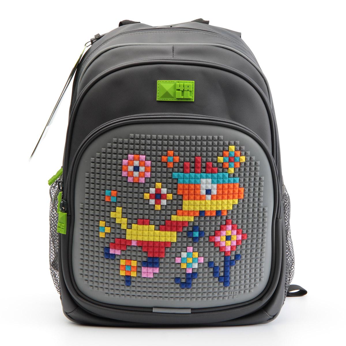 4ALL Рюкзак Kids цвет серый72523WDРюкзак 4ALL - это одновременно яркий, функциональный школьный аксессуар и площадка для самовыражения. Уникальные рюкзаки Kids имеют гипоаллергенную силиконовую панель и разноцветные мозаичные биты, с помощью которых на рюкзаке можно создавать графические шедевры хоть каждый день!Модель выполнена из полиэстера с водоотталкивающей пропиткой. Рюкзак имеет 2 отделения, снаружи расположены 3 кармана (передний - на молнии, боковые - сетчатые). Система Air Comfort System обеспечивает свободную циркуляцию воздуха между задней стенкой рюкзака и спиной ребенка. Система Ergo System служит равномерному распределению нагрузки на спину ребенка, сохранению правильной осанки. Она способна сделать рюкзак, наполненный учебниками, легким.Ортопедическая спинка как корсет поддерживает позвоночник, правильно распределяя нагрузку. Простая и удобная конструкция спины и лямок позволяет использовать рюкзак даже деткам от 3-х лет.Светоотражающие вставки отвечают за безопасность ребенка в темное время суток.В комплекте 1 упаковка разноцветных пикселей-битов (300 штук) и инструкция для создания базовой картинки. Работа с мелкими битами позволяет дополнительно развивать мелкую моторику рук малыша.