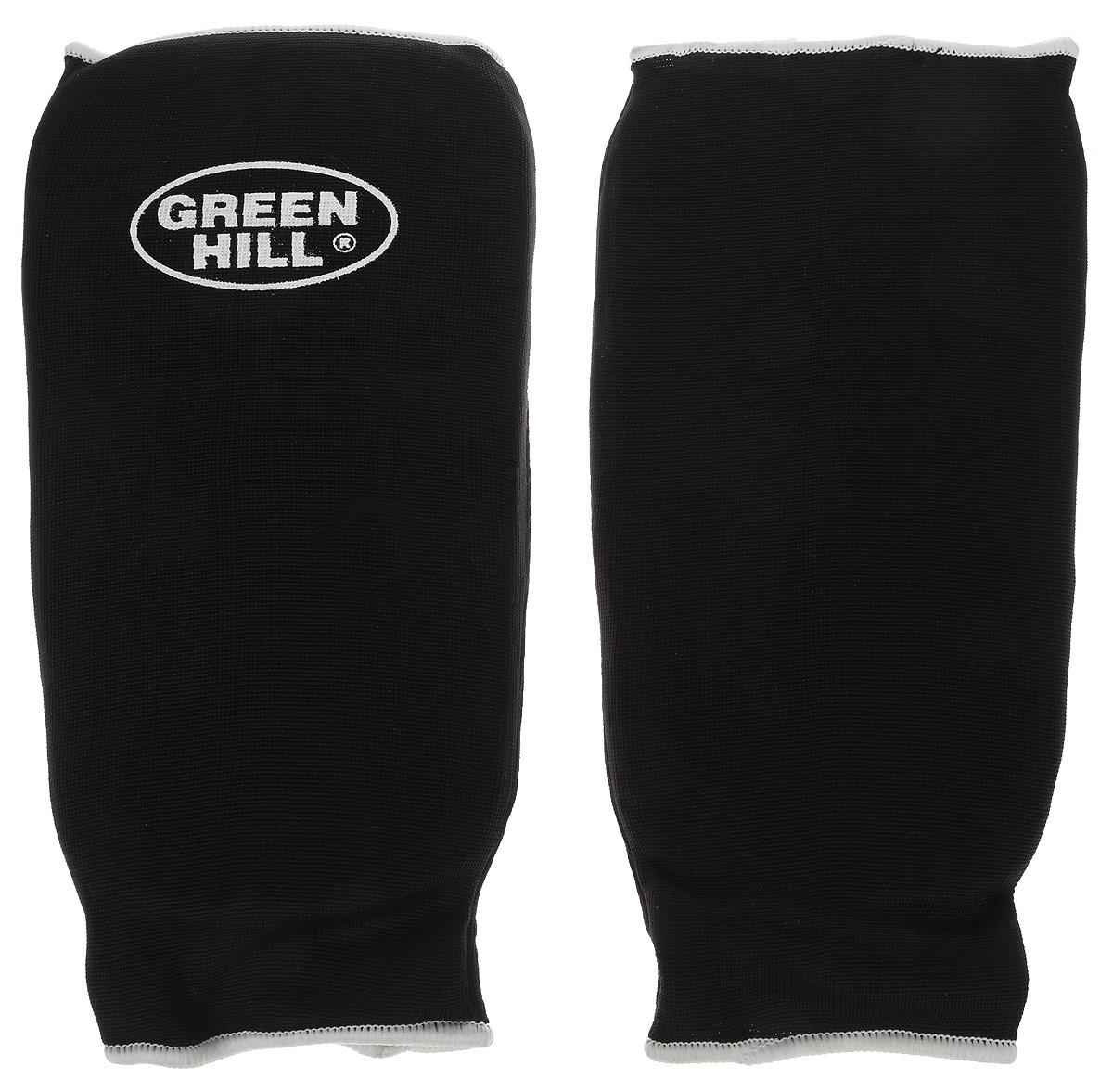 Защита голени Green Hill, цвет: черный, белый. Размер L. SPC-6210N.MS.34.023.LGЗащита голени Green Hill с наполнителем, выполненным из вспененного полимера, необходима при занятиях спортом для защиты суставов от вывихов, ушибов и прочих повреждений. Накладки выполнены из высококачественного эластана и хлопка.Длина голени: 28 см.Ширина голени: 16 см.