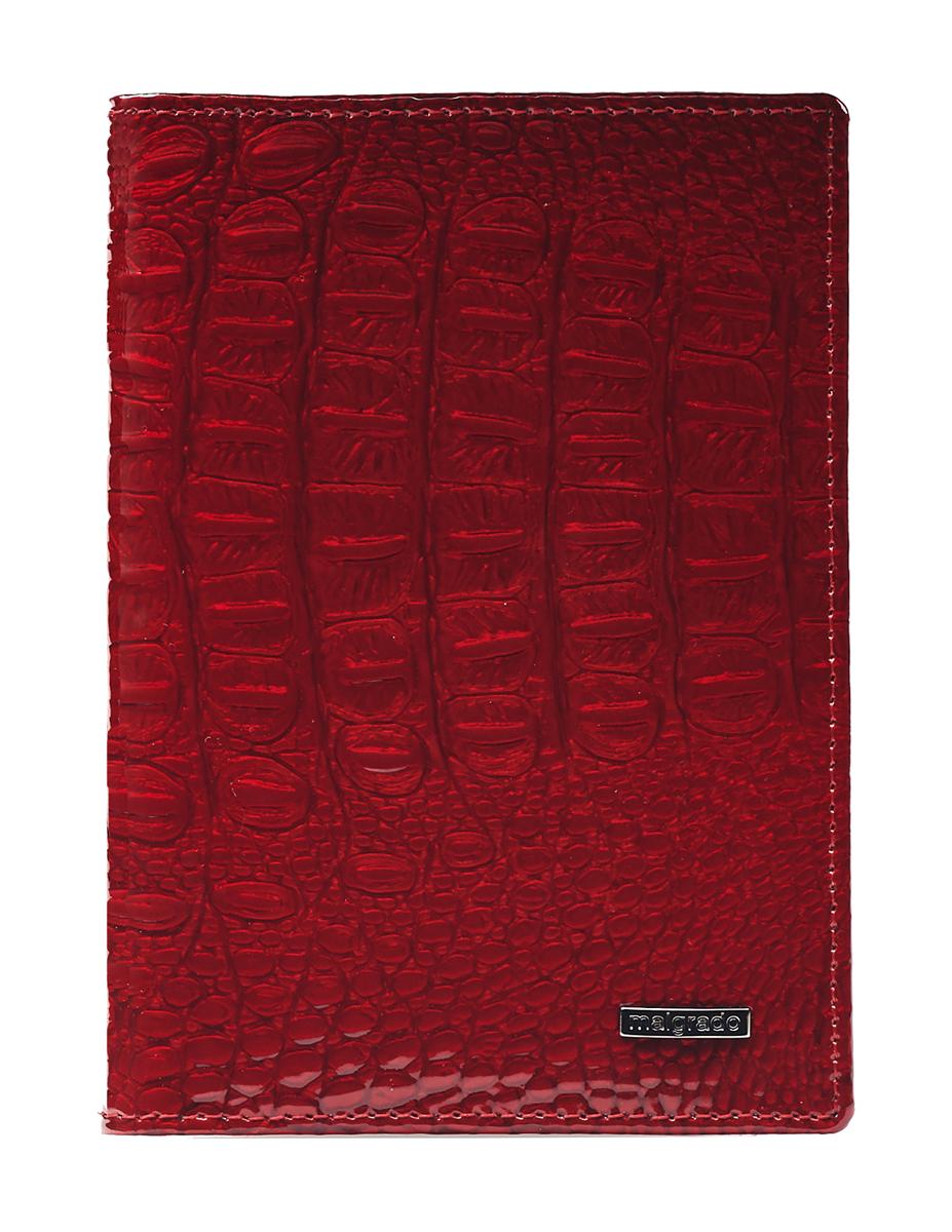 Обложка для паспорта женская Malgrado, цвет: красный. 54019-0170154019-01701 RedСтильная обложка для паспорта Malgrado выполнена из натуральной лакированной кожи с тиснением под рептилию и оформлена металлической фурнитурой с символикой бренда.Изделие раскладывается пополам. Внутри расположены два накладных кармана, один из которых дополнен прозрачной вставкой из пластика, и пять накладных кармашков для пластиковых карт или визиток. Изделие дополнено съемным блоком для хранения автодокументов. Блок включает в себя четыре стандартных файла, один файл для хранения водительского удостоверения и один файл формата А3. Обложка для паспорта поставляется в фирменной упаковке.Обложка для паспорта поможет сохранить внешний вид ваших документов и защитит их от повреждений, а также станет стильным аксессуаром, который подчеркнет ваш образ.