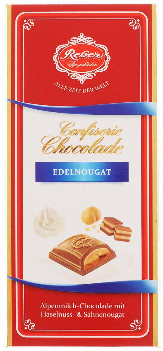 Reber Nougat молочный шоколад с ореховым и сливочным пралине, 100 г0120710Reber Nougat - нежный молочный шоколад из альпийского молока с двуслойной начинкой из сливочного и орехового пралине. Ракушка сделана из довольно толстого слоя шоколада, поэтому она очень приятно ломается, хрустит и сохраняет собственную форму и вкус. Шоколад из альпийского молока приготовлен по семейному рецепту Reber.