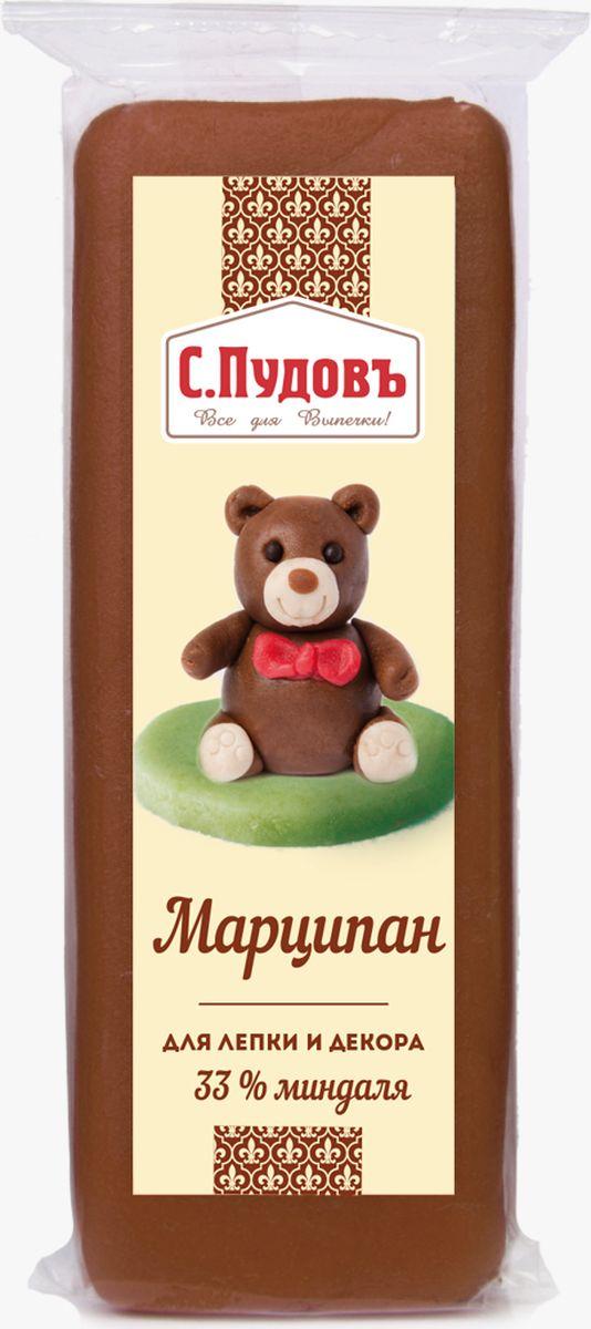 Пудовъ марципан коричневый, 100 г0120710Коричневый марципан Пудовъ - это натуральный продукт с высоким содержанием молотого миндаля, доля которого составляет 33%. Благодаря сбалансированному составу и нейтральному цвету, он идеально подходит для украшения тортов любой тематики. Особенно красиво смотрятся изготовленные из него банты, будто шоколадные цветы, бусины и пуговки в сочетании с белым цветом.Содержит красители, которые могут оказывать отрицательное влияние на активность и внимание детей.