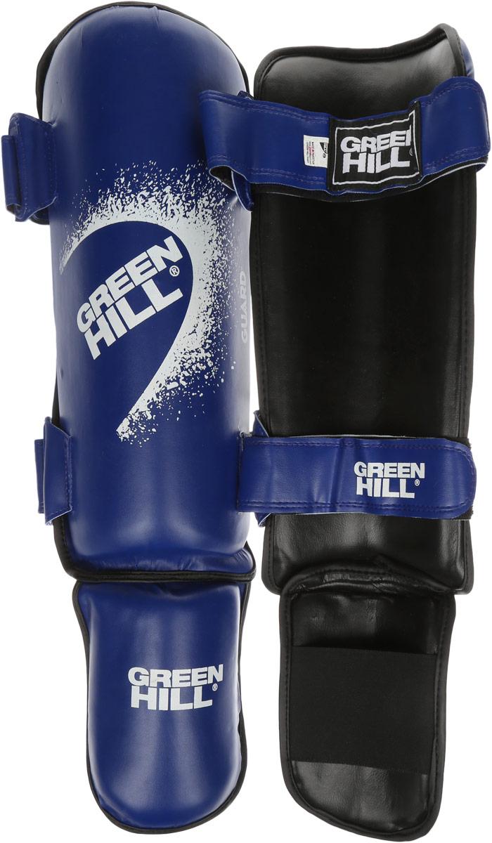 Защита голени и стопы Green Hill Guard, цвет: синий, белый. Размер XL. SIG-0012AIRWHEEL Q3-340WH-BLACKЗащита голени и стопы Green Hill Guard с наполнителем, выполненным из вспененного полимера, необходима при занятиях спортом для защиты пальцев и суставов от вывихов, ушибов и прочих повреждений. Накладки выполнены из высококачественной искусственной кожи. Они прочно фиксируются за счет эластичной ленты и липучек.Удобные и эргономичные накладки Green Hill Guard идеально подойдут для занятий тхэквондо и другими видами единоборств.Длина голени: 36 см.Ширина голени: 14 см.Длина стопы: 16,5 см.Ширина стопы: 11 см.