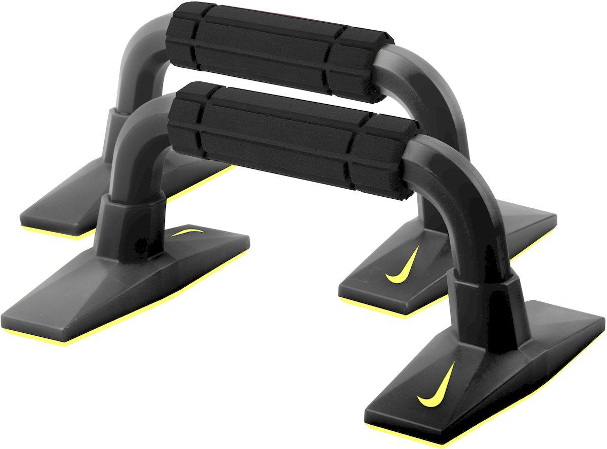 Упоры для отжиманий Nike Push Up Grip 2.0, цвет: черный, желтый, 2 шт1301188Упоры для отжиманий Nike Push Up Grip 2.0 выполнены из полипропилена и резины. Традиционную технику выполнения отжиманий можно существенно дополнить, используя упоры для отжиманий - эффективный инструмент, который позволяет развивать и укреплять мышцы рук, груди и плечевого пояса, развивает выносливость. Приподнятая позиция дает возможность совершать разнообразные упражнения для укрепления грудных и плечевых мышц, трицепсов. Широкие основания обеспечивают надёжную устойчивость. Эргономичный дизайн снижает давление на запястья. Порадуйте себя полезным и прочным тренажером.Размер упора (в собранном виде): 27 х 16 х 12 см.