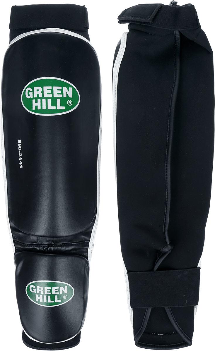 Защита голени и стопы Green Hill Cover, цвет: черный, белый. Размер S. SIС-2141N.VP.07.100.MLЗащита голени и стопы Green Hill Cover с наполнителем, выполненным из полипропилена, необходима при занятиях спортом для защиты пальцев и суставов от вывихов, ушибов и прочих повреждений. Накладки выполнены из высококачественной искусственной кожи. Они прочно фиксируются за счет эластичной ленты и липучек.Длина голени: 27 см.Ширина голени: 15 см.Длина стопы: 14 см.Ширина стопы: 11,5 см.