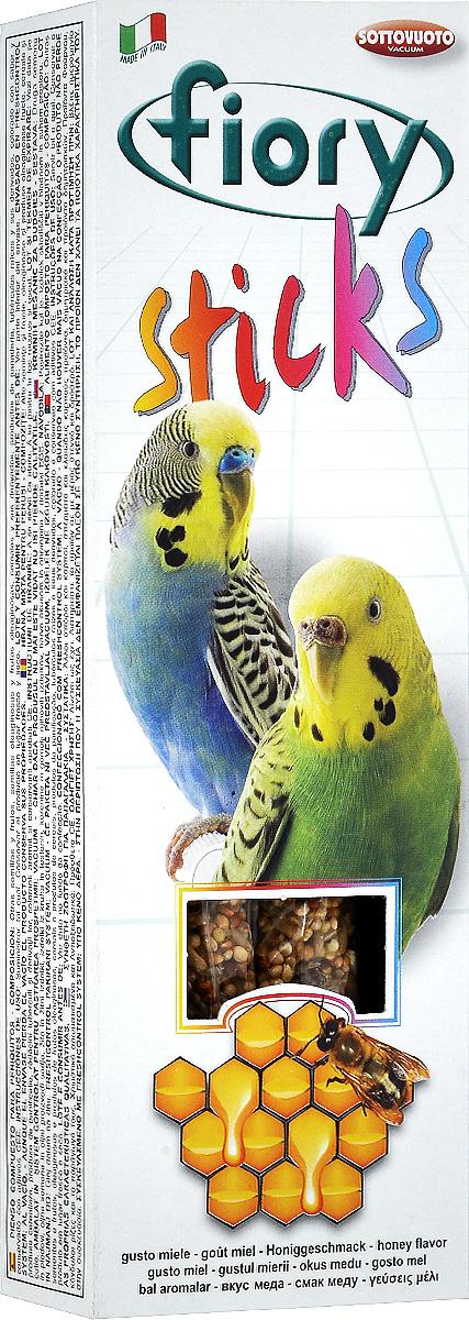 Палочки для попугаев Fiory Sticks, с медом, 2 х 30 г0120710Fiory Sticks палочки для попугаев с медомПалочки с девятью различными элементами, среди которых есть семена сафлора, слегка маслянистого по составу (полезен при запорах, а также используется для улучшения пигментации оперения птиц). Клейкий элемент особенно вкусен, позволяет птицам легко его клевать, не раскалывая их на части и не разбрасывая крошки по дну клетки. Поскольку продукт отличается высоким содержанием белка, им не следует злоупотреблять. Как и все подобного рода дополнительное питание, палочки считаются лакомством и являются добавкой к обычному рациону. Палочки удобны для закрепления в клетке, а попугаю удобно склевывать отдельные семечки, не ломая при этом всю палочку. Ингредиенты: зерно, булочные изделия, дрожжи, кукурузные хлопья, натуральные красители и антиоксиданты, одобренные Советом Европы.