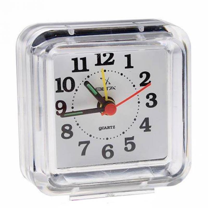 Часы-будильник Вега Классика. Б1-022Б1-022Настольные кварцевые часы Вега Классика изготовлены из прозрачного пластика. Часы имеют четыре стрелки - часовую, минутную, секундную и стрелку завода.Такие часы красиво и оригинально украсят интерьер дома или рабочий стол в офисе. Также часы могут стать уникальным, полезным подарком для родственников, коллег, знакомых и близких.Часы работают от батарейки типа АА (в комплект не входит). Имеется инструкция по эксплуатации на русском языке.