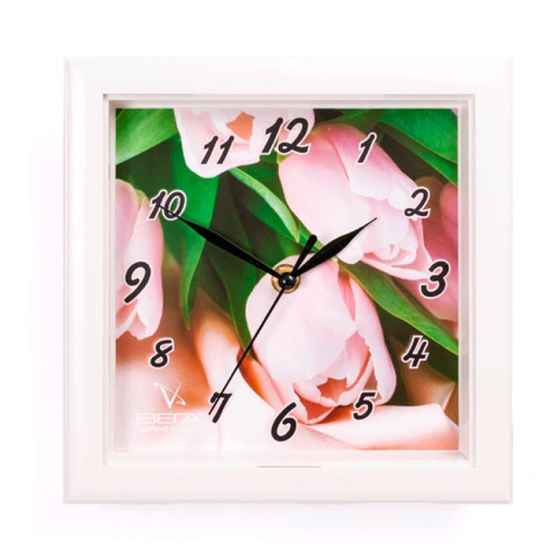 Часы настенные Вега Тюльпаны94672Оригинальные настенные часы квадратной формы Вега Тюльпаны выполнены из пластика. Часы имеют три стрелки - часовую, минутную и секундную. Необычное дизайнерское решение и качество исполнения придутся по вкусу каждому. Оформите свой дом таким интерьерным аксессуаром или преподнесите его в качестве презента друзьям, и они оценят ваш оригинальный вкус и неординарность подарка.Часы работают от 1 батарейки типа АА напряжением 1,5 В (в комплект не входит).