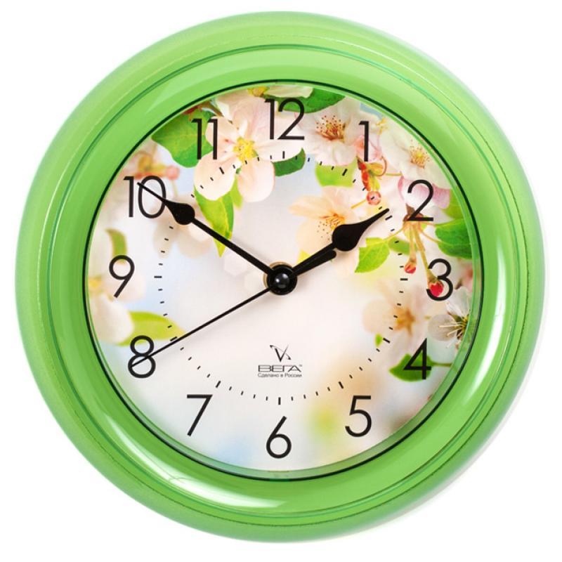 Часы настенные Вега Яблони94672Оригинальные настенные часы круглой формы Вега Яблони выполнены из пластика. Часы имеют три стрелки - часовую, минутную и секундную. Необычное дизайнерское решение и качество исполнения придутся по вкусу каждому. Оформите свой дом таким интерьерным аксессуаром или преподнесите его в качестве презента друзьям, и они оценят ваш оригинальный вкус и неординарность подарка.Часы работают от 1 батарейки типа АА напряжением 1,5 В (в комплект не входит).