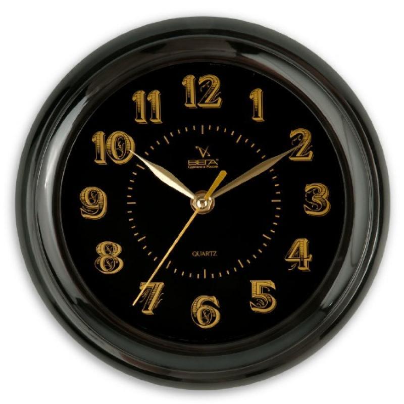 Часы настенные Вега Классика, цвет: черныйП1-6/6-16Оригинальные настенные часы круглой формы Вега Классика выполнены из пластика. Часы имеют три стрелки - часовую, минутную и секундную. Необычное дизайнерское решение и качество исполнения придутся по вкусу каждому. Оформите свой дом таким интерьерным аксессуаром или преподнесите его в качестве презента друзьям, и они оценят ваш оригинальный вкус и неординарность подарка.Часы работают от 1 батарейки типа АА напряжением 1,5 В (в комплект не входит).
